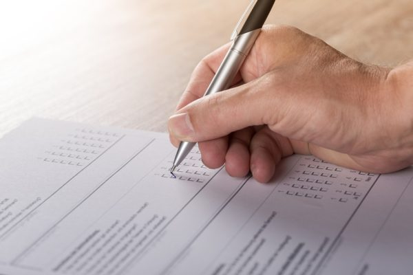 Filling Out Paper Survey | How to Create A Resident Feedback Process